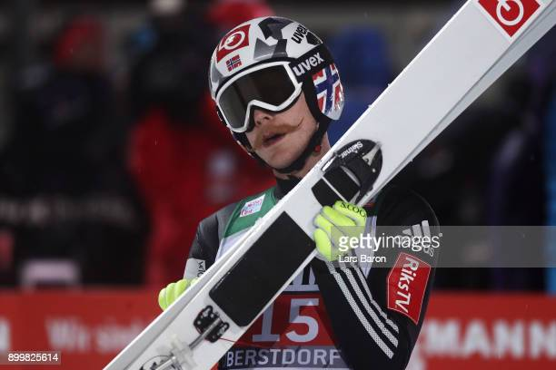 Robert Johansson of Norway look on after he competes in the FIS Nordic World Cup on day 2 of the Four Hills Tournament ski jumping event on December...