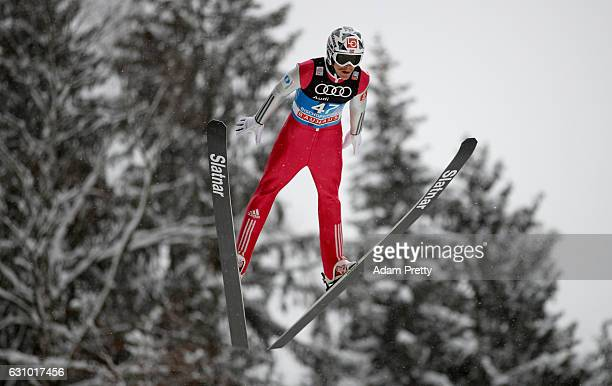 Robert Johansson of Norway soars through the air during his training jump on Day 1 of the 65th Four Hills Tournament ski jumping event on January 5...