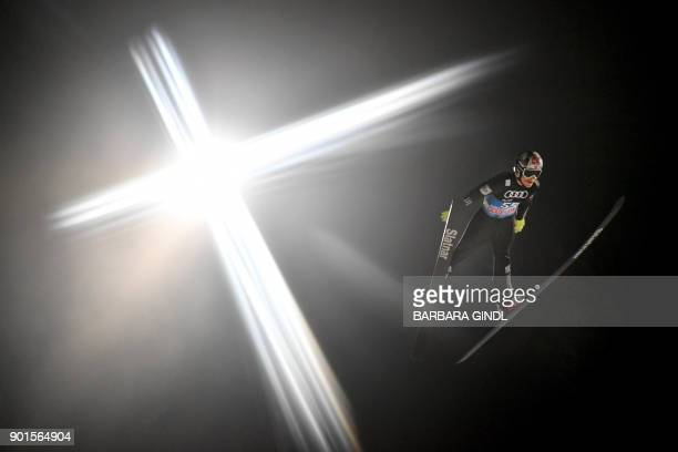 TOPSHOT Robert Johansson of Norway soars through the air during the qualification for the fourth and final stage of the FourHills Ski Jumping...