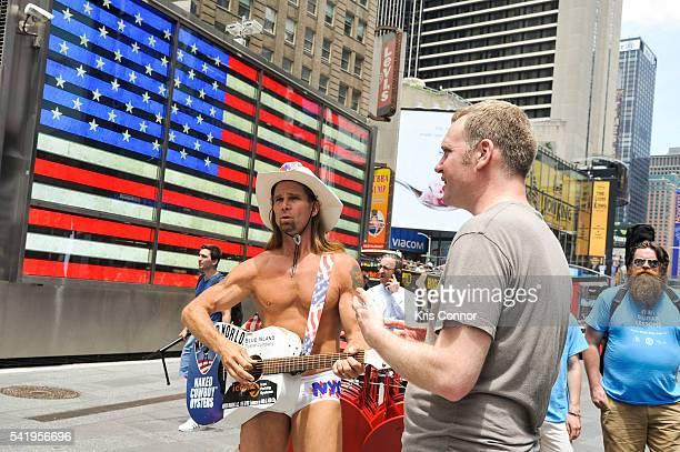 Robert John Burck aka The Naked Cowboy speaks with Aaron Freedman National Organizer of Make Music Day during Make Music Day Guitar Lessons/Mass...