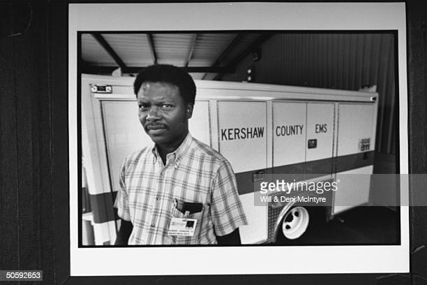 Robert Johnson dir of Kershaw County's Emergency Medical Service posing beside ambulance as he recalls the horrors of working the rescue operation...