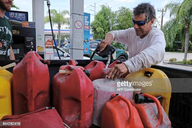Robert Johnson fills gas containers at a gas station in Miami Florida on September 8 ahead of Hurricane Irma Florida Governor Rick Scott warned that...