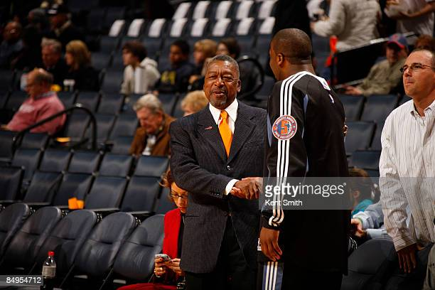 Robert Johnson of the Charlotte Bobcats shakes the hand of Raymond Felton on February 20 2009 at the Time Warner Cable Arena in Charlotte North...
