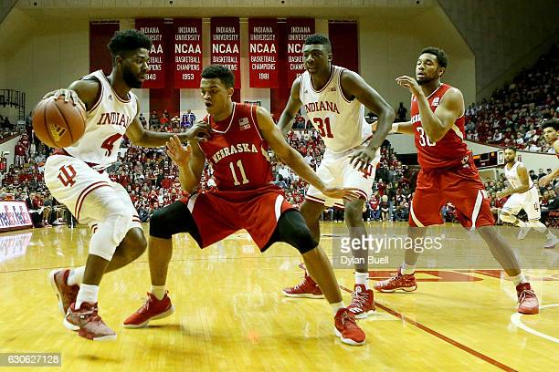 Robert Johnson of the Indiana Hoosiers dribbles the ball while being guarded by Evan Taylor of the Nebraska Cornhuskers in the first half at Assembly...