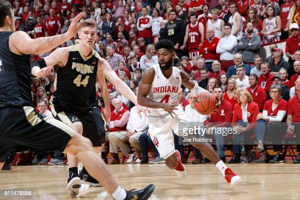 Robert Johnson of the Indiana Hoosiers drives against Isaac Haas of the Purdue Boilermakers in the first half of a game at Assembly Hall on January...