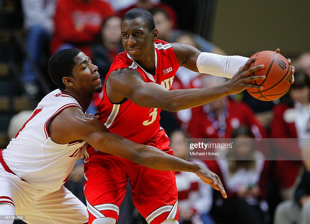 Robert Johnson #4 of the Indiana Hoosiers reaches in as Shannon Scott #3 of the Ohio State Buckeyes holds the ball at Assembly Hall on January 10, 2015 in Bloomington, Indiana. Indiana defeated Ohio State 69-66.