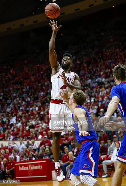 Robert Johnson of the Indiana Hoosiers shoots the ball over Isaac White of the UMass Lowell River Hawks at Assembly Hall on November 16 2016 in...