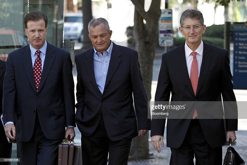 Robert Kaluza, a well site manager for BP Plc during the 2010 explosion on board the Deepwater Horizon oil rig, center, arrives at federal court with his attorneys Shaun Clarke, left, and David Gerger, right, on in New Orleans, Louisiana, U.S., on Wednesday, Nov. 28, 2012. Kaluza, who supervised testing on the Macondo oil well, and another site manager Donald Vidrine, were charged Nov. 15 with involuntary manslaughter, seaman's manslaughter and Clean Water Act Violations. The U.S. alleges that Kaluza and Vidrine ignored multiple indications that the well wasn't secure before the explosion that killed 11 aboard the drilling rig. Photographer: Derick E. Hingle/Bloomberg via Getty Images