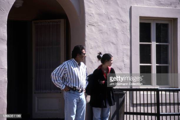 Robert Kardashian and his daughter Kim Kardashian stand outside of her private high school Marymount High School in Los Angeles 1996