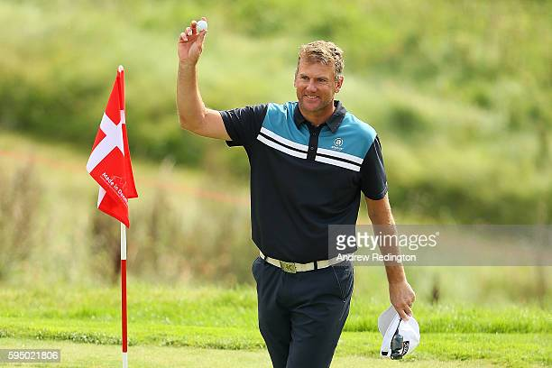 Robert Karlsson of Sweden celebrates a hole in one on the 16th hole during the first round of Made in Denmark at Himmerland Golf & Spa Resort on...
