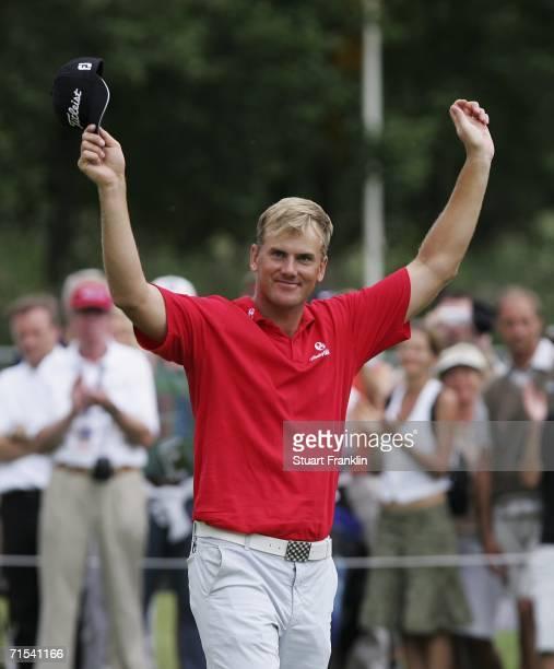 Robert Karlsson of Sweden celebrates winning The Deutsche Bank Players Championship of Europe at Gut Kaden Golf and Land Club on July 30, 2006 in...