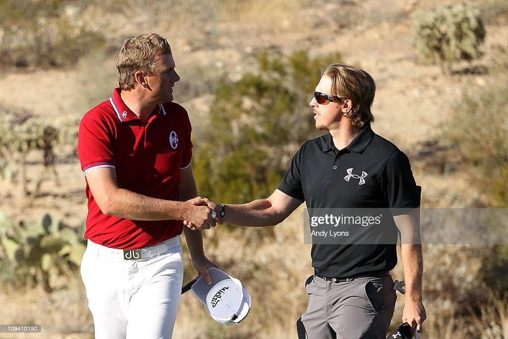 Robert Karlsson of Sweden (L) congratulates Hunter Mahan (R) on his win on the 18th hole during the second round of the Accenture Match Play Championship at the Ritz-Carlton Golf Club on February 24, 2011 in Marana, Arizona.