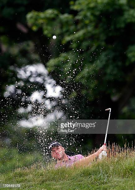 Robert Karlsson of Sweden hits a shot from a bunker on the 14th hole during Round One of the 113th U.S. Open at Merion Golf Club on June 13, 2013 in...
