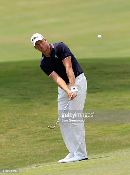 Robert Karlsson of Sweden hits a shot on the 7th hole during the third round of the FedEx St. Jude Classic at TPC Southwind on June 11, 2011 in...