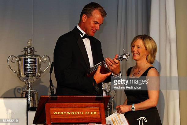 Robert Karlsson of Sweden looks at the Vardon Trophy alongside Hazel Irvine at The European Tour Dinner during the BMW PGA Championship at Wentworth...