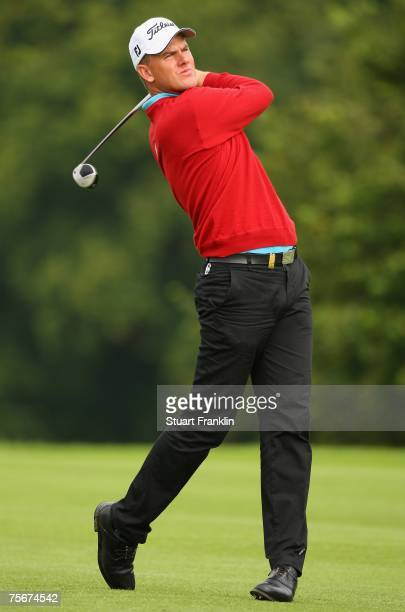 Robert Karlsson of Sweden plays his approach shot on the 15th hole during the first round of The Deutsche Bank Players Championship of Europe at Gut...