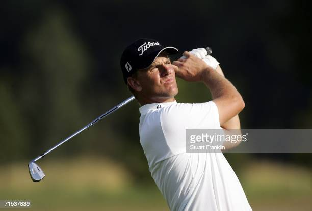 Robert Karlsson of Sweden plays his approach shot on the 18th hole during the third round of The Deutsche Bank Players Championship of Europe at Gut...