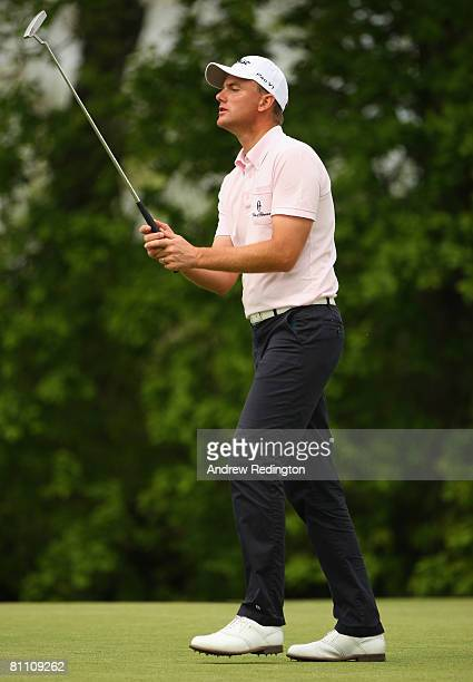 Robert Karlsson of Sweden reacts after missing his eagle putt on the 13th hole during the second round of the Irish Open on May 16 2008 at the Adare...