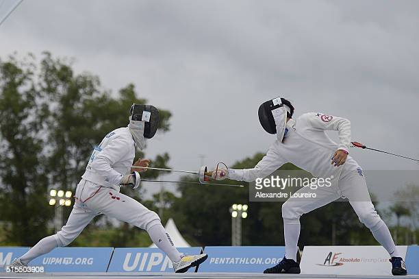 Robert Kasza of Hungria and Woongtae Jun of South Korea competes in the Fencing during the Men's Modern Pentathlon Tournament Aquece Rio Test Event...