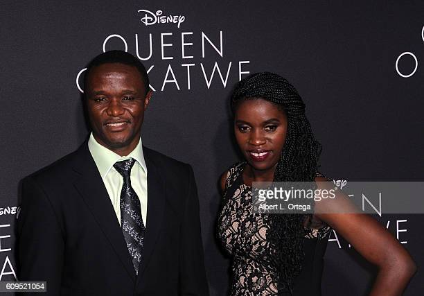 Robert Katende and Phiona Mutesi arrives for the Premiere Of Disney's Queen Of Katwe held at the El Capitan Theatre on September 20 2016 in Hollywood...