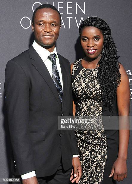 Robert Katende and Phiona Mutesi attend the premiere of Disney's 'Queen Of Katwe' at the El Capitan Theatre on September 20 2016 in Hollywood...