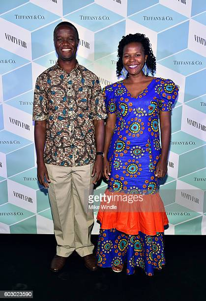 Robert Katende and Sarah Katende attend the Vanity Fair and Tiffany Co private dinner toasting Lupita Nyong'o and celebrating Legendary Style at...