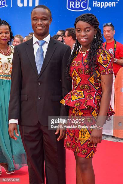 Robert Katende {L} and Phiona Mutesi attend the 'Queen of Katwe' premiere during the 2016 Toronto International Film Festival at the Roy Thomson Hall...