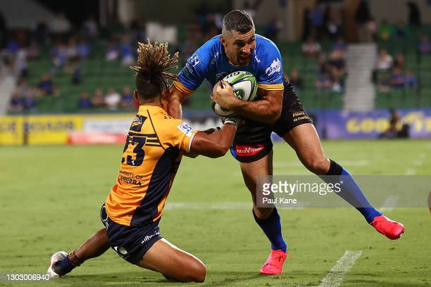Robert Kearney of the Force fends off a tackle by Issak Fines-Leleiwasa of the Brumbies during the round one Super RugbyAU match between the Western...