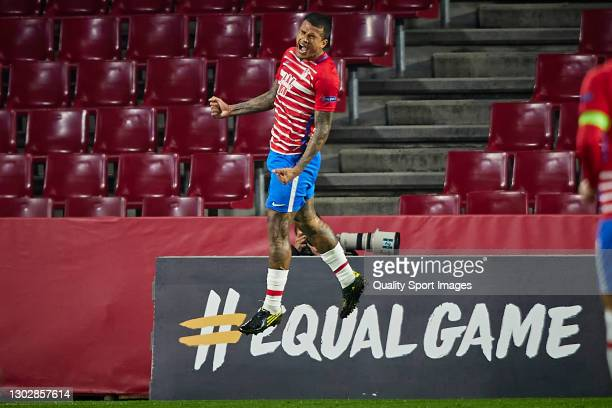 Robert Kenedy of Granada CF celebrates after scoring his team's second goal during the UEFA Europa League Round of 32 match between Granada CF and...