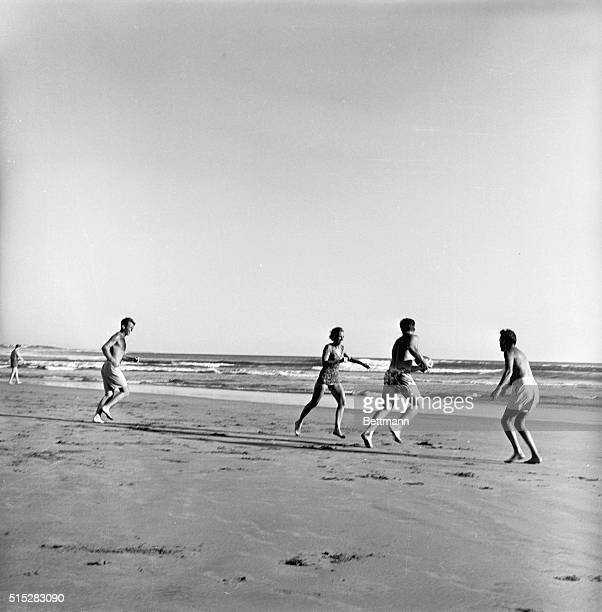 Robert Kennedy brother of US Presidentelect John F Kennedy interrupted a brisk touchball game on the beach here 11/19 to decline comment on reports...
