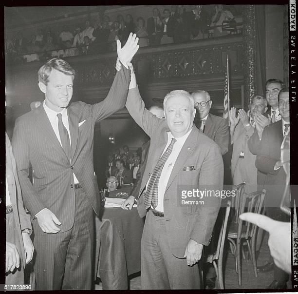 Robert Kennedy Democratic candidate for Senator from New York has his hand raised by David Dubinsky President of the International Ladies Garment...