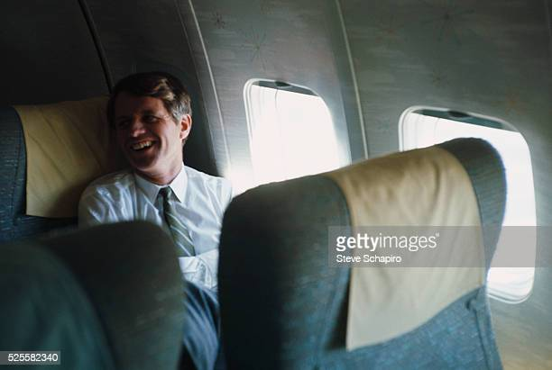 Robert Kennedy riding in his campaign airplane over Indiana April 24 1967