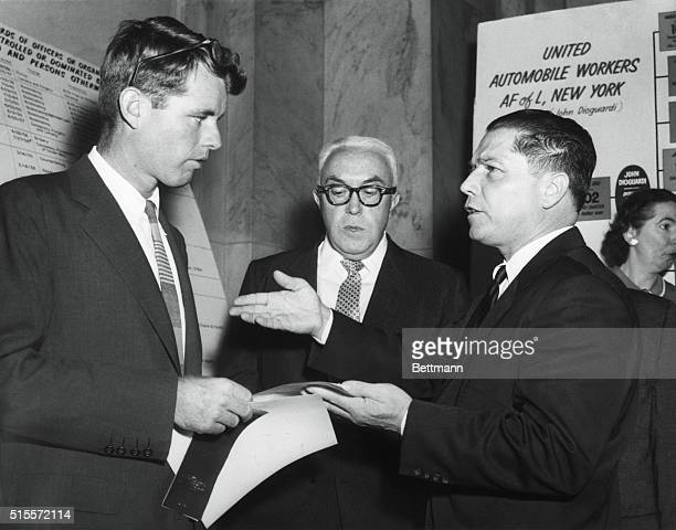 Robert Kennedy speaks with labor leader Jimmy Hoffa. Kennedy was chief counsel for the Senate Rackets Committee, and investigated Hoffa's ties to...