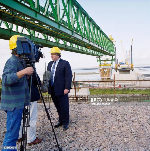 Robert Key, Transport Minister, being interviewed on camera while visiting the Second Severn Crossing construction site during the installation of...