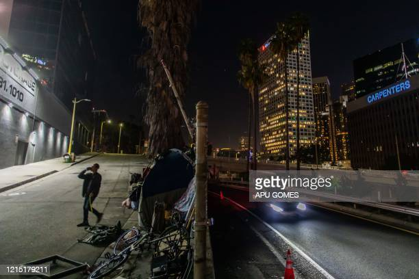 Robert King Geiser 35 yearsold after 2 years living on the streetdrinks a beer outside his tent next to the 110 Freeway during the novel Coronavirus...