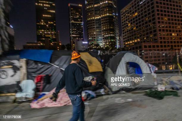 Robert King Geiser 35 yearsold after 2 years living on the street walks outside his tent while he drinks a beer next to the 110 Freeway during the...