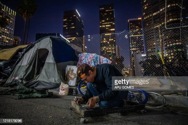Robert King Geiser 35 yearsold after 2 years living on the street writes his lifeline outside his tent next to the 110 Freeway during the novel...
