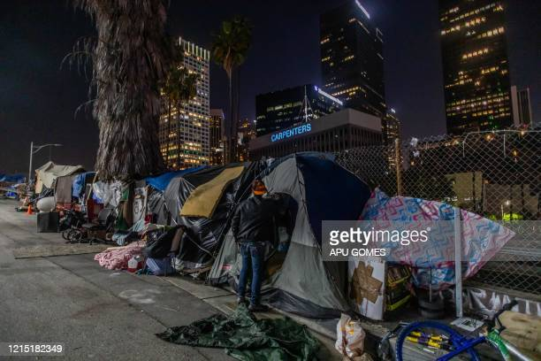 Robert King Geiser 35 yearsold after 2 years living on the street stands outside his tent next to the 110 Freeway during the novel Coronavirus...