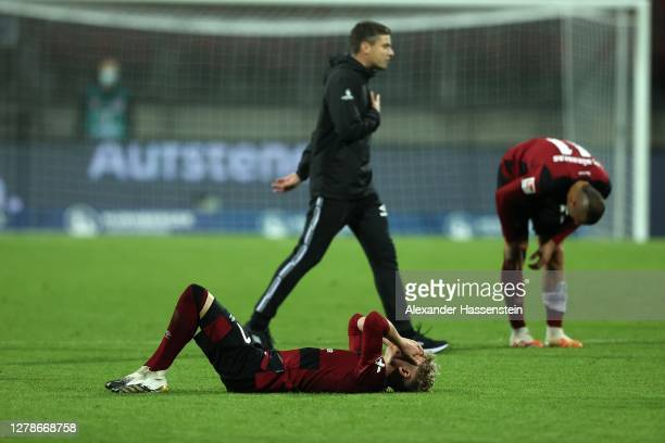 Robert Klauss, head coach of Nürnberg reacts with his players after the Second Bundesliga match between 1. FC Nürnberg and SV Darmstadt 98 at...