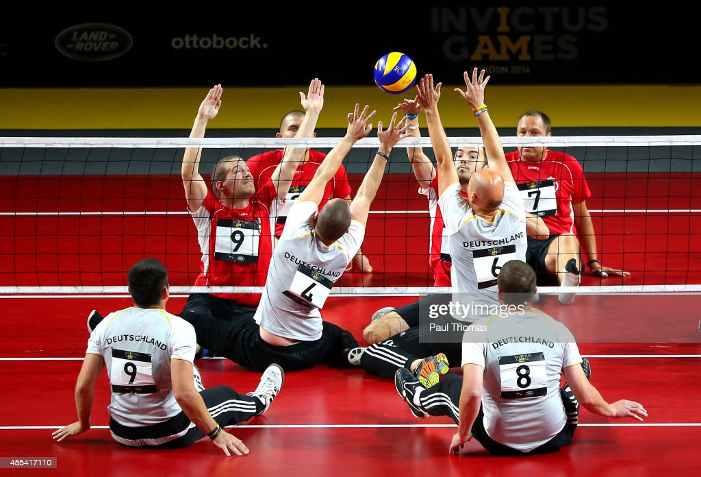 Robert Kloss and Michael Frenzke of Germany compete in the Sitting Volleyball 5th/6th Place Playoff between Denmark and Germany at the Copper Box Arena on day four of the Invictus Games, presented by Jaguar Land Rover at Queen Elizabeth Olympic Park on September 14, 2014 in London, England.