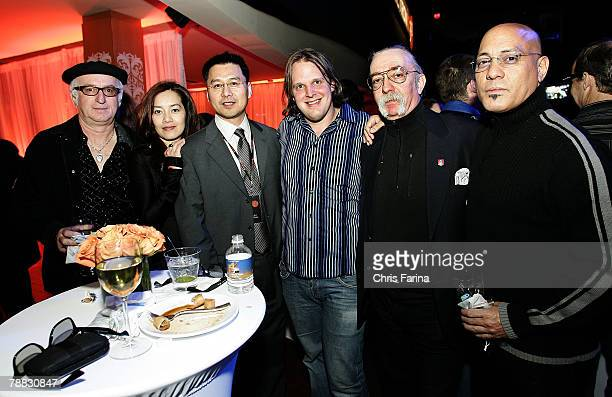Robert Knight Emily Chen Spectroniq CEO Leo Chen Joe Bonamassa Jeff Skunk Baxter and guest attend the Spectroniq 3D CES Party at The Joint at the...