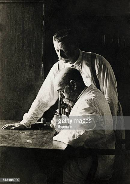 Robert Koch 18431910 the founder of bacteriology and discoverer of the Cholera and tubercular bacillus in his study with his oldest student and...