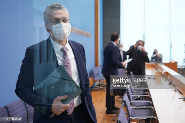 Robert Koch Institute President Lothar Wieler and other health officials depart after speaking at a press conference over the current situation...