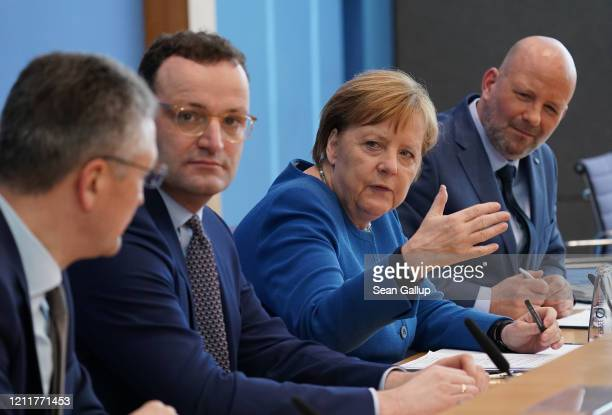 Robert Koch Institute President Lothar Wieler Health Minister Jens Spahn and German Chancellor Angela Merkel speak to the media over the ongoing...