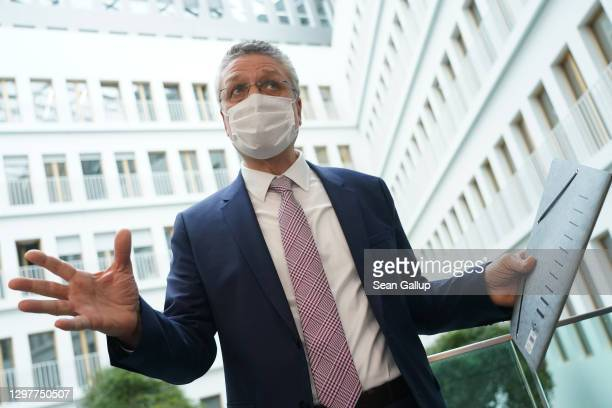 Robert Koch Institute President Lothar Wieler speaks to journalists before departing after taking part in a press conference over the current...