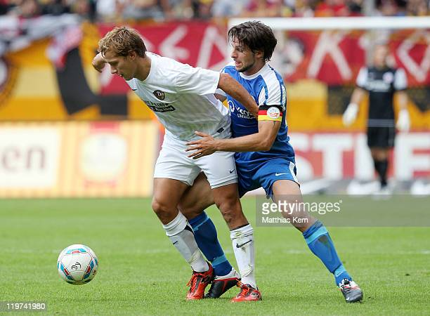 Robert Koch of Dresden battles for the ball with Sebastian Pelzer of Rostock during the Second Bundesliga match between SG Dynamo Dresden and FC...