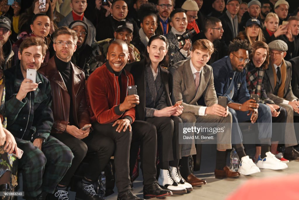 Robert Konjic, Darren Kennedy, Eric Underwood, Erin OÕConnor, Toby Huntington-Whiteley, Jesiah Sampson, Hector Bellerin and Ollie Proudlock sit in the front row at the Oliver Spencer LFWM AW18 Catwalk Show at the BFC Show Space on January 6, 2018 in London, England.