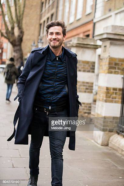 Robert Konjic enters the Coach show in a dark blue jacket blue zebraprint zip jacket and black trousers during The London Collections Men AW16 on...
