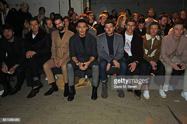 Robert Konjic Paul Sculfor Jack Guinness Hu Bing Jim Chapman Darren Kennedy Dougie Poynter and Roman Kemp attend the TOPMAN DESIGN show during London...