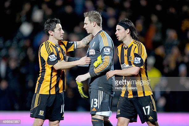 Robert Koren of Hull City consoles Robbie Stockdale of Fulham after the Barclays Premier League match between Hull City and Fulham at KC stadium on...